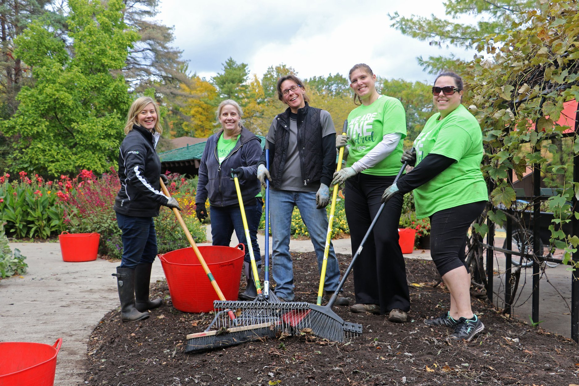 Dow Garden volunteers with rakes