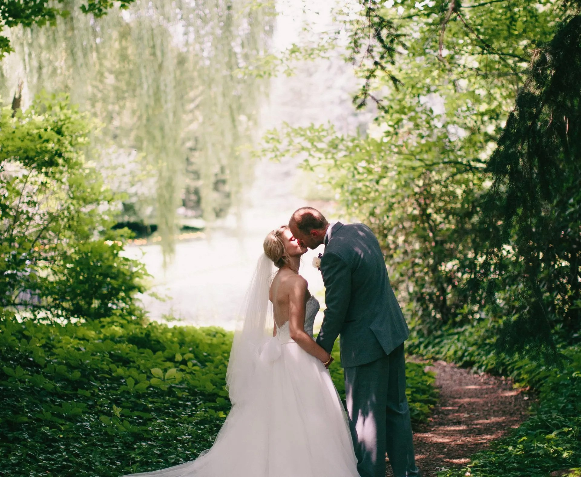 Bride and Groom kissing at Dow Gardens